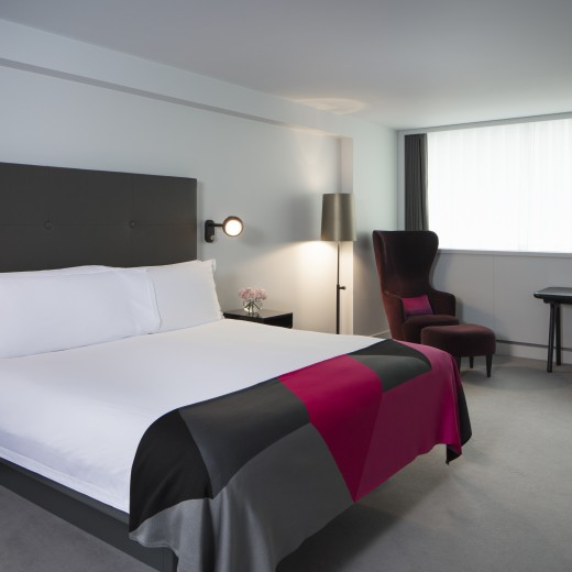 Studio hotel rooms feature a king-sized bed, comfortable lounge and study area