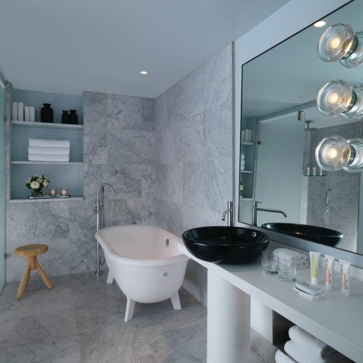 Our Studio rooms have a large bathroom with marble lined walls complete with a rainfall shower and a freestanding bath